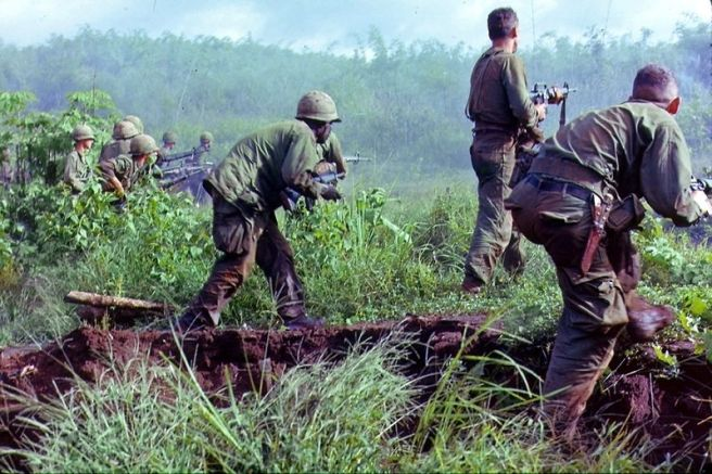 Caption: Soldiers with equipment in Vietnam War 1966 (from the National Archives and Records Administration, ARC ID 530611)
