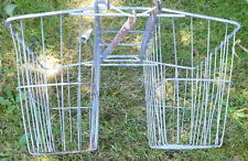 Sturdy wire baskets for bicycle, viewed from the seat end