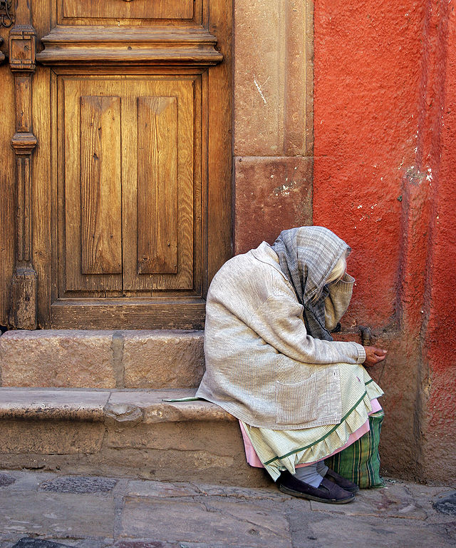 "One Face of Poverty: ""Old lady at San Miguel Allende, Guanajuato, Mexico"" by Tomas Castelazo, at Wikimedia"
