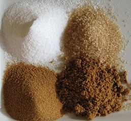 Sugars; clockwise from top left: White refined, unrefined, brown, unprocessed cane. From Romain Behar on Wikimedia